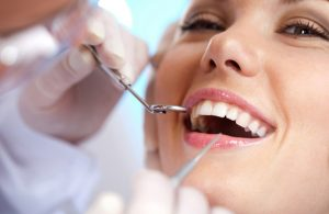 teeth-cleaning-300x195