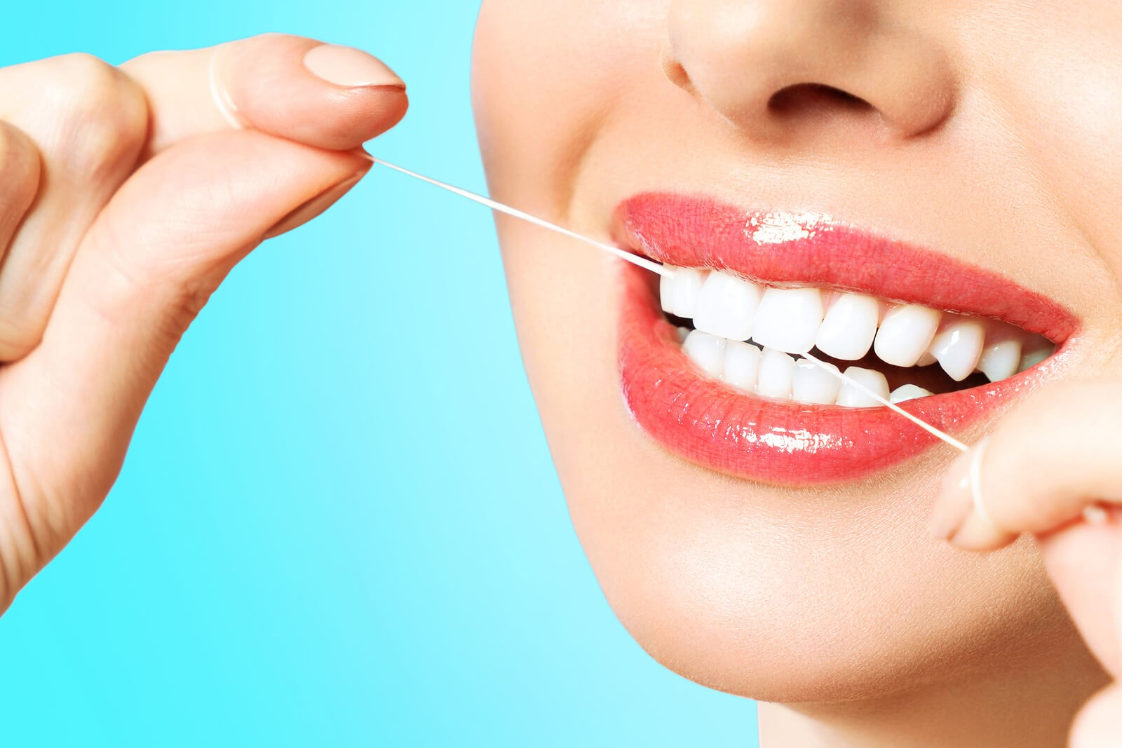 How to Floss Your Teeth Using the Holistic Approach